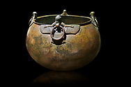 Phrygian bronze couldron with decorated winged figure handles . From Gordion. Phrygian Collection, 8th century BC - Museum of Anatolian Civilisations Ankara. Turkey. Against a black background .<br /> <br /> If you prefer you can also buy from our ALAMY PHOTO LIBRARY  Collection visit : https://www.alamy.com/portfolio/paul-williams-funkystock/phrygian-antiquities.html  - Type into the LOWER SEARCH WITHIN GALLERY box to refine search by adding background colour, place, museum etc<br /> <br /> Visit our CLASSICAL WORLD PHOTO COLLECTIONS for more photos to download or buy as wall art prints https://funkystock.photoshelter.com/gallery-collection/Classical-Era-Historic-Sites-Archaeological-Sites-Pictures-Images/C0000g4bSGiDL9rw