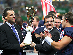 16.07.2011, Ernst Happel Stadion, Wien, AUT, American Football WM 2011, United States of America (USA) vs Canada (CAN), im Bild Tommy Wiking (IFAF President) and Norbert Darbos (Sport and Ministery of Defense Austria) with the Trophy and Cody Hawkins (USA, #7, QB)  // during the American Football World Championship 2011 game, USA vs Canada, at Ernst Happel Stadion, Wien, 2011-07-16, EXPA Pictures © 2011, PhotoCredit: EXPA/ T. Haumer