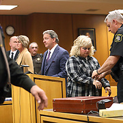 Sharon Evans is handcuffed at the conclusion of her sentencing hearing in her animal cruelty case in Judge Michael Olsaver's courtroom in Lenawee County Circuit Court in Adrian, Mich., on Wednesday, Nov. 13, 2019. THE BLADE/KURT STEISS<br /> CTY EVANS14