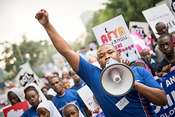 """16 June 2017, Nairobi, Kenya: Youth pastor Felix Mutiso from the Nairobi Calvari Temple. On 16 June, more than 500 people gathered to commemorate the Day of the African Child in Nairobi, Kenya, and to speak up publicly for the rights of children and adolescents living with HIV. Religious leaders from a range of different faith communities and traditions led a march through the streets of Nairobi, from the All Saints Cathedral to Ufungamano House, accompanied by hundreds of youth and young children from local faith-sponsored schools, after which a ceremony was held where the religious leaders committed publicly to work for children's rights to HIV testing, access to treatment, and freedom from stigma and discrimination, to make sure that those who are in need of treatment are also able to stay on treatment. The day was organized by the World Council of Churches Ecumenical Advocay Alliance together with Inerela+ Kenya, with contributions from a range of other partners. At end of the ceremony, the WCC-EAA launched a global Call to Action entitled """"Act now for children and adolescents living with HIV"""", which was signed by the range of religious leaders."""