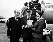 The first direct flight to Dublin from the USA was operated by TWA (Trans World Airways) with a Boeing 707. Miss T Bergin, Carlow, (Aer Rianta) presented the captain with a crystal vase. Included in the picture is Mr Liam Boyd, Manager in Ireland for TWA. <br /> <br /> 02/05/1974