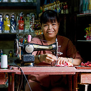 Vietnamese woman making doll clothes with old fashioned sewing machine (Hoi An, Vietnam - Nov. 2008) (Image ID: 081108-1545041a)