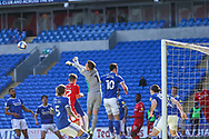 Cardiff City's Goalkeeper Dillon Phillips (1) punches clear during the EFL Sky Bet Championship match between Cardiff City and Nottingham Forest at the Cardiff City Stadium, Cardiff, Wales on 2 April 2021.