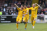 Photo: Pete Lorence.<br />Lincoln City v Bristol Rovers. Coca Cola League 2. Play off, Semi Final 2nd Leg. 17/05/2007.<br />Stuart Campbell celebrates scoring an early goal with Byron Anthony and Chris Curruthers.