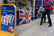 A Union Jack flag with the faces of Royal Wedding couple Prince William and Kate Middleton outside souvenir shop.