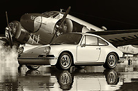 The Porsche 911 is arguably the most popular sports car that has ever been introduced onto the market. The basic concept of owning a sports car has been around since the 1920's and, until the release of the Porsche 911, it was the sportiest automobile in the world. The Porsche 911 pictured in black and white is the most iconic sports car that has ever been produced by Porsche and is arguably the most popular sports car in the world. The styling of the Porsche 911 is sleek and tidy and even if the vehicle has been laden down with high levels of horsepower, it is still considered as one of the sleekest and fastest sports cars that has ever been produced.