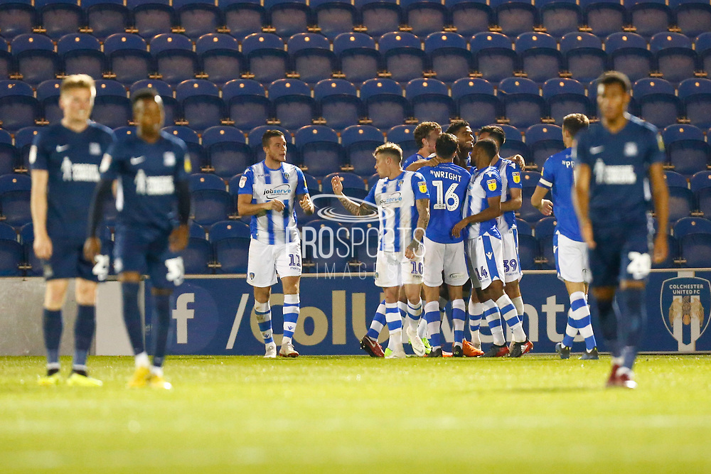 Colchester United forward Aaron Collins (39) scores and celebrates during the EFL Trophy match between Colchester United and Southend United at the Weston Homes Community Stadium, Colchester, England on 9 October 2018.