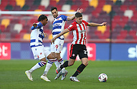 Brentford's Vitaly Janelt holds off Reading's Sam Baldock and Michael Olise<br /> <br /> Photographer Rob Newell/CameraSport<br /> <br /> The EFL Sky Bet Championship - Brentford v Reading - Saturday 19th December 2020 - Brentford Community Stadium - Brentford<br /> <br /> World Copyright © 2020 CameraSport. All rights reserved. 43 Linden Ave. Countesthorpe. Leicester. England. LE8 5PG - Tel: +44 (0) 116 277 4147 - admin@camerasport.com - www.camerasport.com