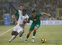 Photo: Steve Bond/Richard Lane Photography.<br />Ghana v Morocco. Africa Cup of Nations. 28/01/2008. Sulley Muntari (L) tangles with Youssef Hadji (R)