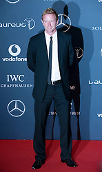 © Licensed to London News Pictures. 06/02/2012. London, UK. Cricketer Paul Collingwood arriving on the red carpet for the Laureus World Sports Awards 2012. Dozens of sports and Hollywood celebrities arrived in the English capital to attend the event held at the Queen Elizabeth II Conference Centre in the same year that London will host the Olympic Games. Photo credit : Ben Cawthra/LNP