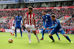 Stoke City's Eric Maxim Choupo-Moting (left) and Leicester City's Christian Fuchs (right) in action