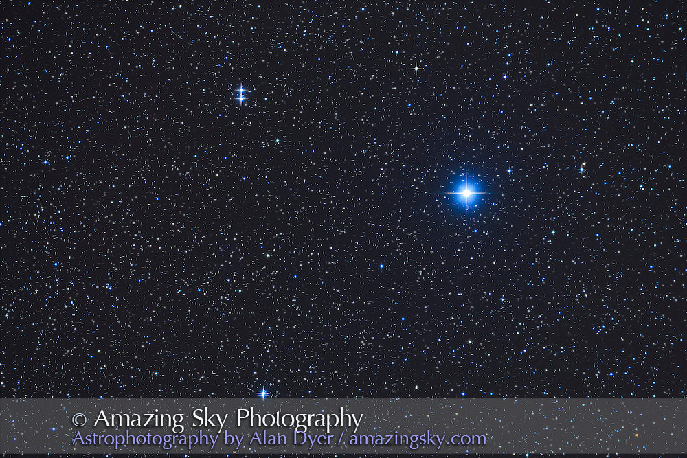 The bright star Vega with the double stars Epsilon Lyrae (top) and Zeta Lyrae (bottom) in Lyra the Harp. <br /> <br /> Taken from home Nov 29, 2016 with the TMB 92mm refractor and Borg 0.85x flattener and Canon 6D at ISO 800 for a stack of 4 x 3 minute exposures. Diffraction spikes added with Astronomy Tools Actions.