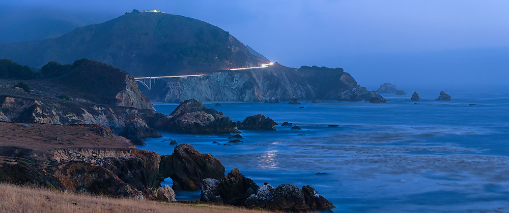 Rocky Creek Bridge on Highway 1 is seen in the distance from along the shores of Garrapata state beach in Big Sur.