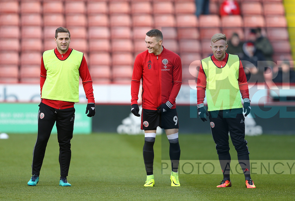 Billy Sharp, Caolan Lavery and Mark Duffy of Sheffield Utd during the English League One match at Bramall Lane Stadium, Sheffield. Picture date: December 26th, 2016. Pic Simon Bellis/Sportimage