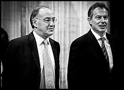 The British Prime Minister Tony Blair and the leader of the Conservative party Michael Howard through the Members Loby at  the House Of Lords on the day of the State Opening of Parliament. PA Photo Andrew Parsons