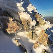 Snow formations on the summit of Arenig Fawr in low winter sunlight.
