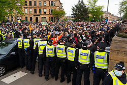 Glasgow, Scotland, UK. 13 May 2021.At approx 5.30 pm police released two men from a Home Office detention vehicle. Accompanied by lawyer Aamer Anwar the men walked to a nearby mosque surrounded by hundreds of police and supporters who had previously been surrounding the vehicle and sitting on the street. Pic; supporters on street in front of the mosque.  Iain Masterton/Alamy Live News
