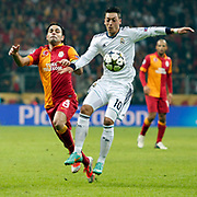 Galatasaray's Selcuk Inan (L) and Real Madrid's Mesut Ozil (R) during their UEFA Champions League Quarter-finals, Second leg match Galatasaray between Real Madrid at the TT Arena AliSamiYen Spor Kompleksi in Istanbul, Turkey on Tuesday 09 April 2013. Photo by Aykut AKICI/TURKPIX