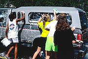 Teens age 14 washing truck for church fund raiser.  Minneapolis Minnesota USA