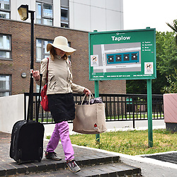 © Licensed to London News Pictures. 24/06/2017. London, UK. Residents are evacuated from the Taplow block on the Chalcots Estate in Camden after it failed a fire inspection because of combustable cladding. More than 700 flats in tower blocks on an estate in the Swiss Cottage area of north-west London are being evacuated because of fire safety concerns. Photo credit: Ben Cawthra/LNP