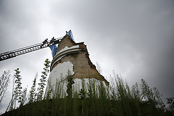 August 1, 2018 - Kathmandu, Nepal - Firefighters carry tarpaulin as they climb on a crane to preserve the Dharahara from rain and other further damages on the initiation of the Deputy Mayor, Hari Prabha Khadki in Kathmandu, Nepal on Wednesday, August 01, 2018. The Dharahara was once a nine-storey tower that collapsed during the earthquake in 2015. (Credit Image: © Skanda Gautam via ZUMA Wire)