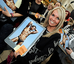 © under license to London News Pictures. 2011.02.05 . Fans with Peter Andre Calandars. Peter Andre at Bluewater signing copies of his 2011 calendar at Clinton Cards store.. Picture credit should read Grant Falvey/London News Pictures.