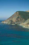 Steep coastal hills and cliffs above bridge along highway one, Big Sur Coast, Monterey County, California