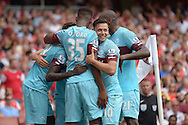 Cheikhou Kouyate of West Ham United celebrates scoring his first goal his teams first goal of the game to make it 0-1 with team mates Dimitri Payet of West Ham United, Reece Oxford of West Ham United and Angelo Ogbonna Obinze of West Ham United. Barclays Premier League, Arsenal v West Ham Utd at the Emirates Stadium in London on Sunday 9th August 2015.<br /> pic by John Patrick Fletcher, Andrew Orchard sports photography.
