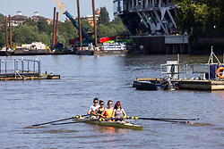 Licensed to London News Pictures. 17/07/2021. London, UK. Rowers get to cool off on the River Thames at Putney Embankment, southwest, London today as weather forecasters predict a very warm and dry Weekend with highs of over 32c in London and the south East with the warm weather lasting up to two weeks. Photo credit: Alex Lentati/LNP