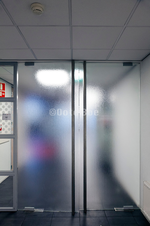 frosted glass door in public space hallway of office building