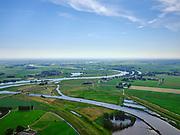 """Nederland, Overijssel, Gemeente Kampen; 21–06-2020; het Reevediep ter plaatse van De Koerskolk, rivier de IJssle in de achtergrond. Voor de aanleg van het Reevediep liep ter hoogte van dit natuurgebied in Kamperveen het riviertje Reeve.<br /> Het Reevediep is aangelegd in het kader van het project Ruimte voor de Rivier om bij hoogwater water af te voeren voordat dit het nabij gelegen Kampen bereikt, direct naar het IJsselmeer, de 'bypass Kampen'. Het Reevediepgebied is ook een natuurgebied en vormt een ecologische verbindingszone tussen rivier de IJssel en Drontermeer.<br /> Reevediep, nature reserve Koerskolk. <br /> The Reevediep has been constructed as part of the Room for the River project, and functions to discharge high waters before reaching the nearby Kampen, directly to the IJsselmeer, the """"bypass Kampen"""". The Reevediep area is also a nature reserve and forms an ecological connecting zone between the river IJssel and Drontermeer.<br /> <br /> luchtfoto (toeslag op standaard tarieven);<br /> aerial photo (additional fee required)<br /> copyright © 2020 foto/photo Siebe Swart"""