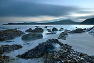 Sunrise over the rocks on Porthselau Beach looking towards St David's Head, Pembrokeshire, Wales