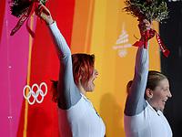 Photo: Catrine Gapper.<br />Winter Olympics, Turin 2006. Womens Bobsleigh. 21/02/2006. <br />Sandra Kiriasis and Anja Schneiderheinze of Germany celebrate their medals.