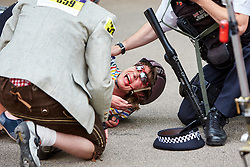 © Licensed to London News Pictures. 01/08/2015. LONDON, UK. A woman lies injured after crashing during the 10th Brompton World Championship bike race. The annual event sees over 500 competitors use the folding bicycles to race round St James' Park for up to 8 laps. Photo credit: Cliff Hide/LNP