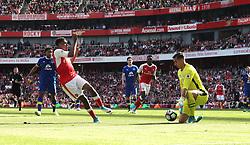 21 May 2017 London : Premier League - Arsenal v Everton :<br /> Alex Iwobi shoots straight at Everton goalkeeper Joel Robles.<br /> Photo: Mark Leech