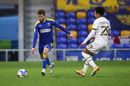 AFC Wimbledon attacker Shane McLoughlin (19) passing the ball down the line during the EFL Sky Bet League 1 match between AFC Wimbledon and Milton Keynes Dons at Plough Lane, London, United Kingdom on 30 January 2021.
