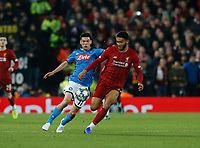 Football - 2019 / 2020 UEFA Champions League - Group E: Liverpool vs. Napoli<br /> J<br /> oe Gomez of Liverpool cases the ball with Hirving Lozano of SSC Napoli  in pursuit, at Anfield.<br /> <br /> COLORSPORT/ALAN MARTIN