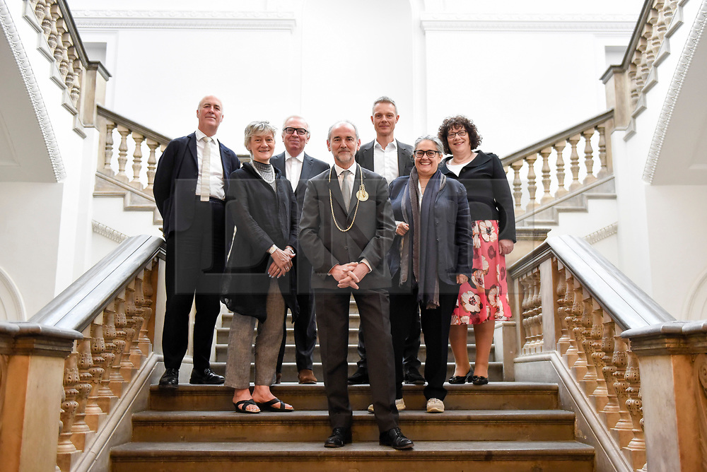 © Licensed to London News Pictures. 14/05/2018. LONDON, UK. (L to R) Charles Saumarez Smith, Chief Executive RA, Rebecca Setter, Keeper RA, Sir David Chipperfield RA, architect, Christopher Le Brun, President RA, Tim Marlow, Artistic Director RA, Tacita Dean, artist, and Ros Kerslake, Heritage Lottery Fund,  at a photocall for the opening of the new Royal Academy of Arts (RA) in Piccadilly.  As part of the celebrations for its 250th anniversary year, redevelopment has seen the RA's two buildings, 6 Burlington Gardens and Burlington House, united into one extended campus and art space extending from Piccadilly to Mayfair.  Photo credit: Stephen Chung/LNP