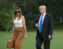 U.S. President Donald Trump, First Lady Melania Trump and their son Barron Trump return to the White House in Washington, DC, after a trip to New Jersey, June 11, 2017. Photo by Chris Kleponis