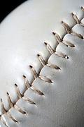 Closeup photograph of a softball and reflection