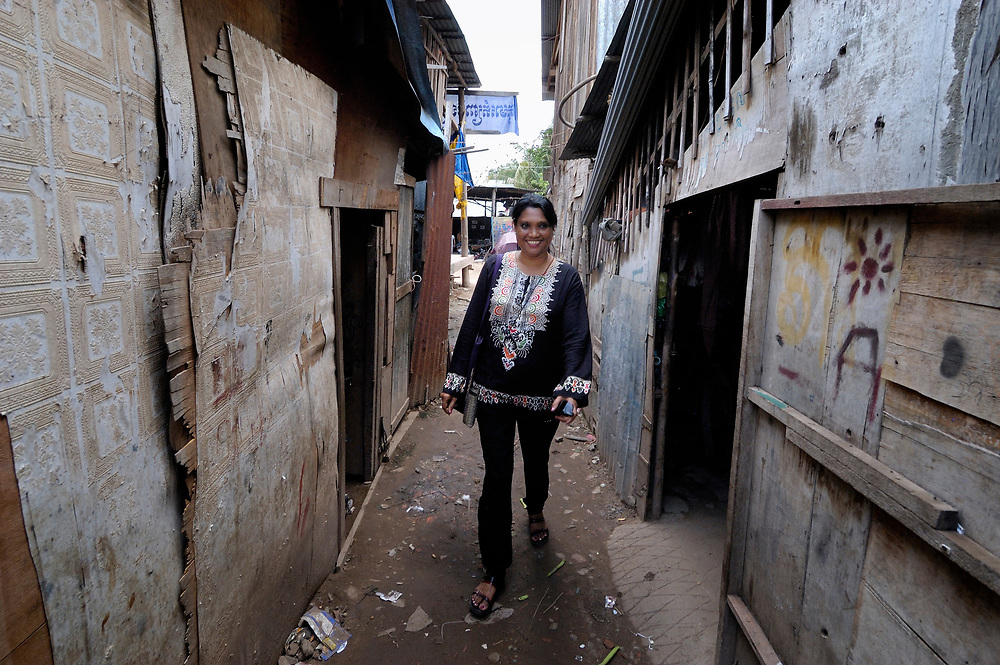 Clara Biswas (left), a United Methodist missionary who works with women and children and youth in the Cambodian capital of Phnom Penh, walks through a poor neighborhood of the city. Biswas is from Bangladesh.