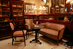 03 Sept 2014. New Orleans, Louisiana. <br /> Stylish tables and chairs at Arnaud's French 75 Bar in the French Quarter.<br /> Photo; Charlie Varley/varleypix.com