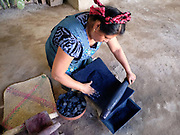 Master dyer Juana Gutierrez Contreras  preparing indigo using a metate grinding stone in the Zapotec weaving village of Teotitlan del Valle, Oaxaca, Mexico on 27 November 2018