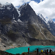 Tourists gather at a viewpoint overlooking the three lakes Quesillococha, Siula and Gangrajanca at the Cordillera Huayhuash trekking circuit, Peru, September 1, 2018. REUTERS/Lisi Niesner