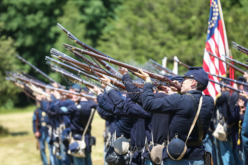 (6/18/16, MILLIS, MA) Re-enactors take aim during the Civil War re-enactment at Oak Grove Farm in Millis on Saturday. Daily News and Wicked Local Photo/Dan Holmes