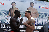Nathan Cleverly of Wales ®  at weigh in preparing for his fight against Sean Corbin of Guyana (l) . Weigh in for the 'second coming' 17th May Cardiff boxing show in Queen Street, Cardiff, South Wales on Friday 16th May 2014.<br /> pic by Andrew Orchard, Andrew Orchard sports photography.
