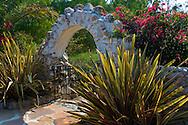 Stone arch and garden at Leo Carillo Ranch Historic Park, near Carlsbad, San Diego County, California
