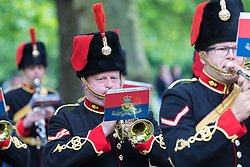 Hyde Park, London, June 2nd 2016. Soldiers and guns of the King's Troop Royal Horse Artillery fire a 41 round Royal Salute to mark the 63rd anniversary of the coronation of Britain's Monarch HM Queen Elizabeth II. PICTURED: The band marches into Hyde Park.