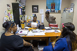Shannon Brewer, center, manager of the Jackson Women's Health Organization, speaks with colleagues in her office, on Tuesday August 19, 2014, in Jackson, Mississippi. This is the only clinic in the entire state that performs abortions. (Photo © Jock Fistick)