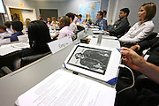 Students at the darden School of Business received training on how to use the new Kindle digital reading device created by Amazon.com. Photo/Andrew Shurtleff.